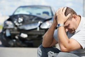 Adult upset driver man in front of automobile crash car collision