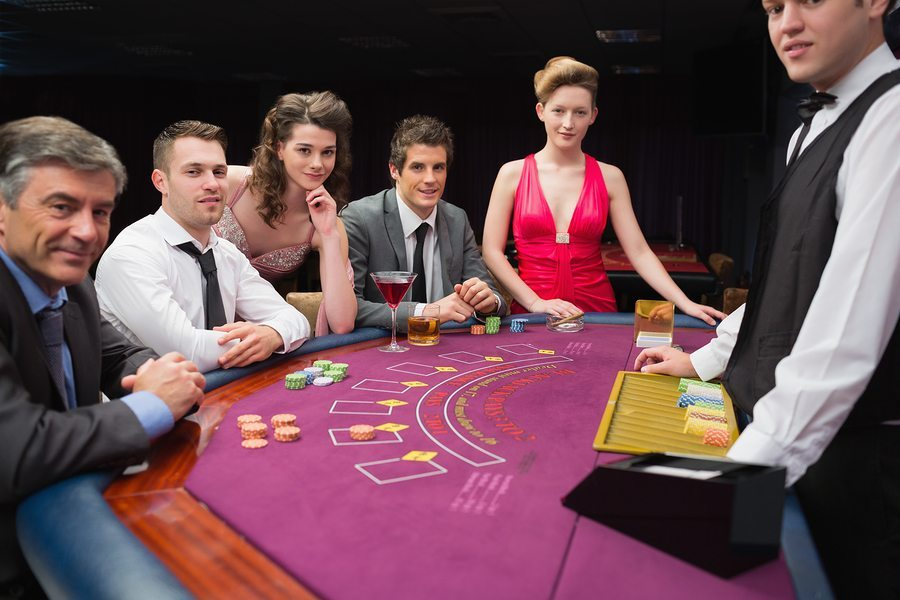 People sitting at a blackjack table at the casino, Casino slips and falls