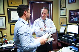 Auto Accident lawyer talking to client in NJ