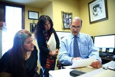 d'agostino attorney discussing a lawsuit